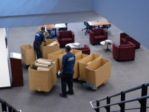 Professional Movers identifying materials and sorting sections.