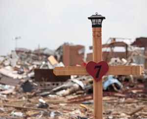 A cross marks the crumbled remains of Plaza Towers Elementary School in Moore, Okla., where seven children were killed. (Dan Gill)