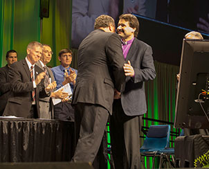 LCMS President Rev. Dr. Matthew C. Harrison greets Bishop Vsevolod Lytkin of the Siberian Evangelical Lutheran Church after delegates affirmed the church bodies' fellowship. (LCMS Communications)