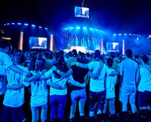"Participants at the LCMS National Youth Gathering join together for a special July 4 Mass Event at the Alamodome to unpack the day's theme, ""live LOVED."" (Nathan Harrmann)"