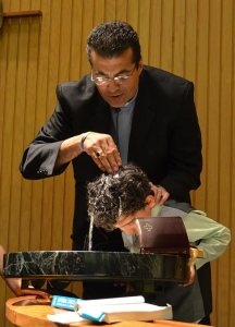 The Rev. Karim Baidaoui, missionary at-large to Muslim people in the LCMS Texas District, baptizes a young boy. Baldaoui heads the ministry in Dallas known as Disciples of the Way. (Disciples of the Way)