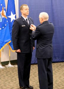 Brigadier General John McGoff of the Indiana National Guard pins the Purple Heart on Captain Michael Frese, an LCMS pastor. (Steve Blakey, BB Design Inc.)