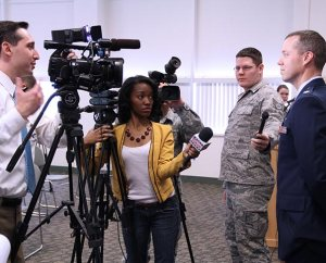 Reporters from local news stations ask questions of Captain Michael Frese, the only LCMS chaplain to receive the award for service in Afghanistan. (Steve Blakey, BB Design Inc.)