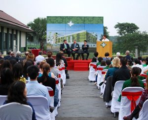 Claire Pierangelo (at podium), deputy chief of mission for the U.S. Embassy in Hanoi and parent of a Concordia International School Hanoi (CISH) student, addresses guests at the March 26 celebration for the start of the first phase of construction on the school's permanent campus in north Hanoi, Vietnam. From left are: Steve Winkelman, CISH head of school; Gregg A. Pinick, Concordia International School Shanghai head of school and a member of the CISH board of directors; and Son Jin Young, project director for Van Tri Development. (J.P. Cima)