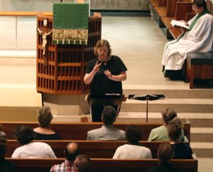 """A student in the Church Interpreter Training Institute (CITI) """"signs"""" during a chapel service at Concordia Theological Seminary, Fort Wayne, Ind. The 2014 CITI is planned for June 15-27 at the seminary. (Concordia Theological Seminary)"""