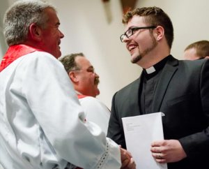Concordia Seminary, St. Louis, President Rev. Dr. Dale Meyer congratulates the Rev. Andrew Rosse on receiving his first call — to Christ the King Lutheran Church in Natchitoches, La. In the background is LCMS President Rev. Dr. Matthew C. Harrison. (LCMS Communications/Erik M. Lunsford)