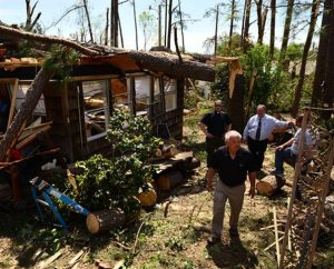 Terry Dufford shows the Rev. Michael Meyer, manager of LCMS Disaster Response, left, and the Rev. David Mac Kain of Holy Trinity Lutheran Church tornado damage to his home in Tupelo, Miss., on May 2. Members of Holy Trinity, Dufford and his wife, Susan, and their two grown children sought shelter in an interior hallway during the tornado. They were not injured. (LCMS Communications/Erik M. Lunsford)