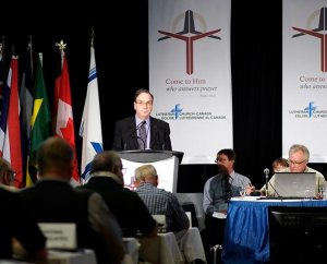 The Rev. Dr. Robert Bugbee speaks to those attending the June 6-9 Lutheran Church—Canada convention in Vancouver, British Columbia, just after delegates elected him by acclamation to his third three-year term as the church body's president. (Gabor Gasztonyi)