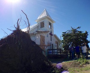 A June 18, 2014, tornado uprooted a tree and damaged Zion Lutheran Church in Wessington Springs, S.D. The storm also severely damaged the church's unoccupied parsonage and the homes of two Zion members. (LCMS Communications/Al Dowbnia)