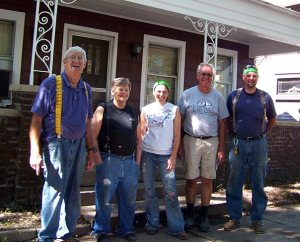 Helping Hand accomplishments are more about newly built relationships with people like Fort Wayne homeowner Tim Jeffries, second from left, than about newly repaired houses. Conversations with Laborers — who include, from left, Tim Brettin, Heidi Wilkinson, Gary Trombley and Steve Reif — prompted Jeffries to attend worship at Emmanuel Lutheran Church. (Lutheran Church Extension Fund)