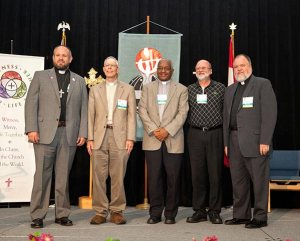 Newly elected English District officers pose for a group photo at the convention. From left are President-Elect Rev. Dr. Jamison Hardy, First Vice-President Rev. Ben Eder, Second Vice-President Rev. Zerit Yohannes, Third Vice-President Rev. Todd Arnold and Fourth Vice-President Rev. Robert Rogers. (Courtesy of LCMS English District)