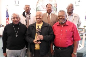 Black Clergy Caucus members — and former students of famed missionary-educator Dr. Rosa Young — pose for a photo with a statue of Young, who died in 1971. Funds raised through sales of the statues will go toward erecting a life-size statue of Young on the campus of Concordia College Alabama in Selma. From left, front, are the Rev. Dr. Bryant Clancy of St. Louis, the Rev. Paul Anderson of Chicago and the Rev. Frank Marshall of New Orleans. In the back, from left, are the Rev. Dr. McNair Ramsey of Selma, the Rev. Dr. Ulmer Marshall of Mobile, Ala., and the Rev. Dr. James Brown of Pensacola, Fla. (LCMS/Paula Schlueter Ross)