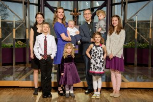 The Rev. Clint and Lalita Hoff, holding, from left, Ezra and Dietrich, pose with the rest of their children: from left, Violette, Kenneth, Bernadette, Evangeline and Cosette. (LCMS/Erik M. Lunsford)