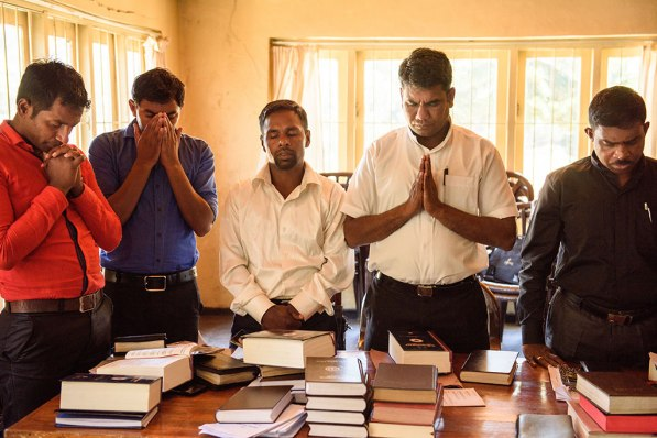 From left, Vicar M. Anton Raj, Vicar G. Arul Pragas, Vicar S. Sebastian, Vicar P. Gnanakumar and the Rev. S. Devanesan pray together.