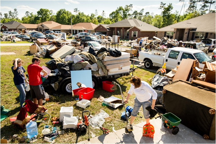 Victims sorting through their belongings after severe floods.