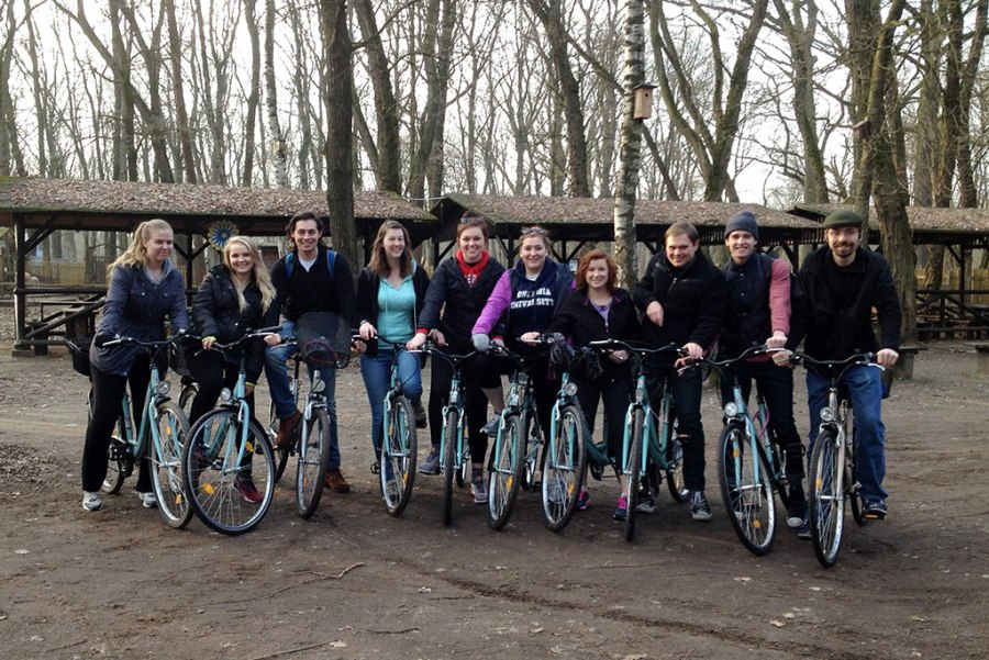 "Students in this spring's Concordia University System study-abroad program take a break from a bike tour of Wittenberg, Germany, including some ""off the beaten path"" sites. (Courtesy of Renata Mayrhofer)"