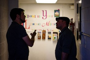 The Rev. Stephen Heimer, left, pastor of nearby Zion Lutheran Church and chief operating officer of Ysleta Lutheran Mission Human Care (YLM), chats with Ahmed Cespedes, a new Cuban immigrant to the United States, at YLM May 20 in El Paso, Texas.