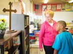 Teacher Nancy Spitzack talks with student Josiah Knox at Lutheran Special School & Education Services, located at Milwaukee Lutheran High School. (LCMS/Erik M. Lunsford)