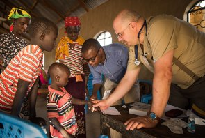Dr. Jeffrey Pruitt, right, a member of St. John Lutheran Church in Defiance, Ohio, works with a Kenyan doctor to treat a young patient.