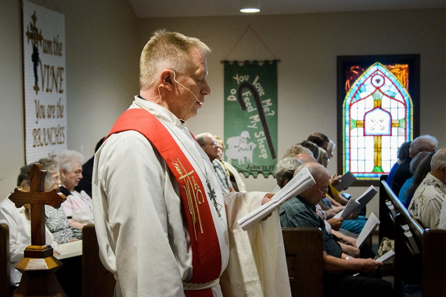 St. John's Lutheran Church Pastor Rev. Terry Makelin conducts the liturgy during the Aug. 28 dedication of St. John's new sanctuary, now that the rebuilding of the church is complete two years after twin tornadoes left only a slab of concrete in their wake. (LCMS/Frank Kohn)