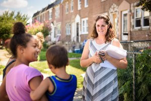 Deaconess Melissa DeGroot meets neighborhood children near Shepherd of the City Lutheran Church in Philadelphia as she distributes fliers for the domestic Mercy Medical Team event there Aug. 26-27. (LCMS/Erik M. Lunsford)