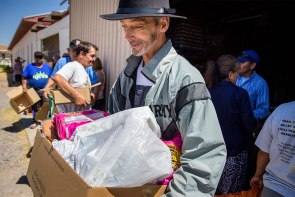 Michael LaBrecque receives a box of free food during the May 21 food distribution at Ysleta Lutheran Mission Human Care (YLM) in El Paso, Texas. YLM, an LCMS Recognized Service Organization, continues to serve Cuban immigrants like LaBrecque who arrived in the U.S. in May under the Cuban Adjustment Act of 1996.