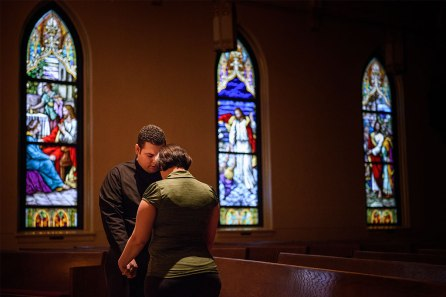Vicar David Blas, missionary at-large at LCMS Sheboygan County Hispanic Outreach and St. John's Lutheran Church in Plymouth, Wis., prays with his wife, Maria, in the church Jan. 28.