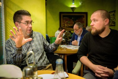 While eating at a small café in Madrid, Missionary Rev. David Warner, left, and Missionary Rev. Adam Lehman discuss plans for their work.