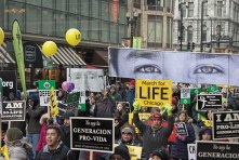 "Marchers carry ""eyes"" through the streets during the Jan. 15 March for Life Chicago."