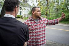 The Rev. Micah Glenn (center), new national missionary to Ferguson, talks about his hometown neighborhood with the Rev. Steve Schave, director of LCMS Urban & Inner-City Mission (UICM) and director of LCMS Church Planting, outside his parents' home on Wednesday, April 20, 2016, in Ferguson, Mo.