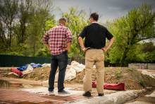The Rev. Micah Glenn, new national missionary to Ferguson, stands Wednesday, April 20, 2016, with the Rev. Steve Schave (right), director of LCMS Urban & Inner-City Mission (UICM) and director of LCMS Church Planting, on the site of the former QuikTrip store in Ferguson, Missouri, which burned down amongst the unrest following the shooting death of Michael Brown almost two years ago. The Lutheran Hope Center of Ferguson will be built at the site.