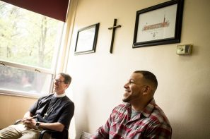 The Rev. Micah Glenn, new national missionary to Ferguson, chats with Lutheran High School North Principal Tim Brackman (not pictured) during a visit to the school with the Rev. Steve Schave, director of LCMS Urban & Inner-City Mission (UICM) and director of LCMS Church Planting, at the school in St. Louis on Wednesday, April 20, 2016.