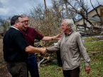 Volunteer Richard Tucker (right) greets LCMS President Rev. Dr. Matthew C. Harrison (far left) and Texas District President Rev. Ken Hennings outside a home heavily damaged by Hurricane Harvey in Rockport, Texas. (LCMS/Erik M. Lunsford)