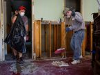 Erik Brown, left, and Eric Hollar, volunteers from Memorial Lutheran Church, Katy, Texas, clear debris Sept. 1 at a home damaged by Hurricane Harvey. (LCMS/Erik M. Lunsford)