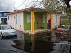 Residents of Puerto Rico wait for the water to recede Sept. 21 following Hurricane Maria. An LCMS Disaster Response team has been on standby, waiting for the military and first responders to clear roads and secure hard-hit areas so that it can enter the country and assess needs. A tentative five-day trip is planned to begin Oct. 5. (Yuisa Rios/FEMA)