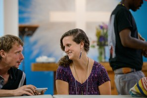 Deaconess Kelly Jacob, coordinator of the Bridge Ministry at Prince of Peace, chats with Mark, a local man, before lunch.