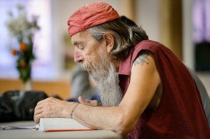 A man participates in a Bible study at a Bridge Ministry event at Prince of Peace Lutheran Church. The Christ-centered ministry reaches out to care for the neighborhood's homeless.