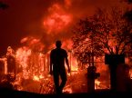 Jim Stites watches his Fountaingrove neighborhood burn in Santa Rosa, Calif., on Monday, Oct. 9. (Kent Porter/The Press Democrat via AP)