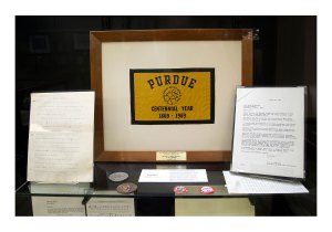 """A Purdue centennial flag that was flown to the moon on Apollo 11 in 1969 is just one of many items on display in """"Apollo in the Archives: Selections from the Neil A. Armstrong Papers."""" (Purdue University/Mark Simons)"""