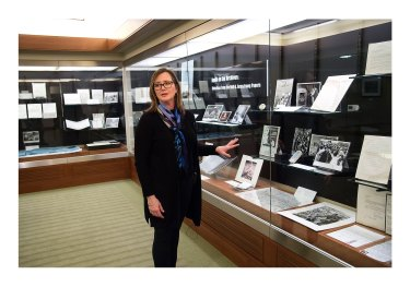 """Tracy Grimm, associate head of Archives and Special Collections and Barron Hilton Archivist for flight and space exploration conducts a tour of """"Apollo in the Archives: Selections from the Neil A. Armstrong Papers"""" exhibition. The exhibition is open from March 18 until Aug. 16. (Purdue University/ Mark Simons)"""