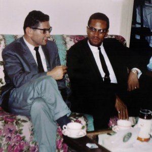 Morroe Berger and Malcolm X listen to jazz records. photo credit: Ed Berger.