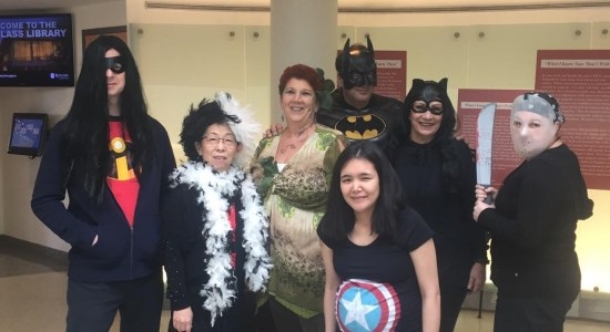 Faculty and staff at Douglass Library in the Halloween spirit.
