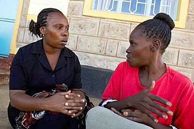 Jane Otai speaks to a traditional birth attendant in Nairobi