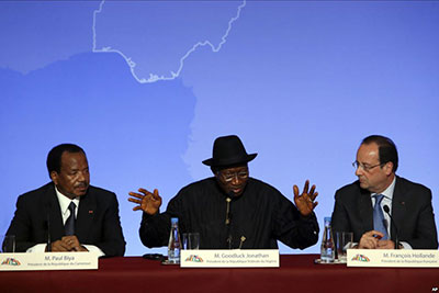 GoodLuck Jonathan in France with the French leader Francois Hollande and the Cameroon President Paul Biya