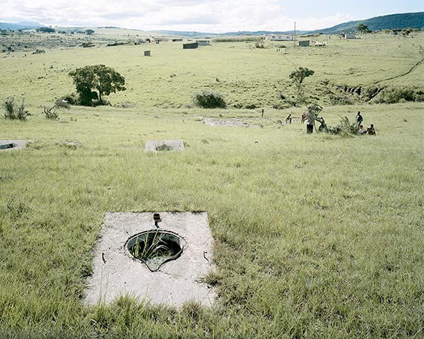 Photo by DAVID GOLDBLATT Remains of long-drop lavatories at Frankfort in the former Ciskei Bantustan. The people of Mgwali strongly resisted their removal to this resettlement camp and the government eventually allowed them to remain on their farms at Mgwali. The lavatories at Frankfort have been stripped of usable materials by the local populace and all that now remains of the scheme are some 1 500 anatomically shaped holes in the veld. Frankfort, Eastern Cape. 2006 Courtesy UCT Libraries Special Collections