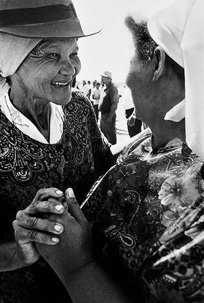 Photo by PAUL WEINBERG Sisters reconnect after 20 years of separation as a result of the apartheid removals, Riemvasmaak, Northern Cape. 1995 Courtesy UCT Libraries Special Collections""