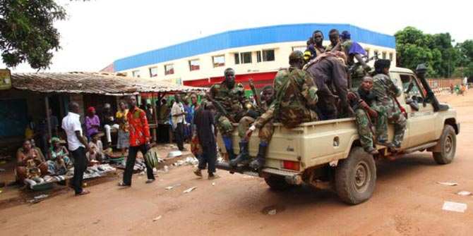 Seleka militia drive past the central market in Bangui, Central African Republic