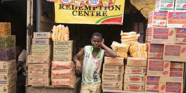 Young Nigerian food trader in his market stall Credit: Camera Press