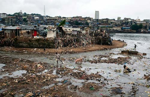 The shore next to Mabella is littered with trash, and untreated sewage flows into the ocean, Freetown, Sierra Leone. Credit: Holly Pickett