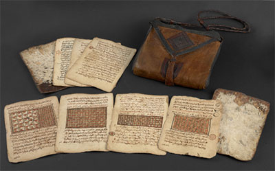 Illuminated loose leaf Qur'an, carried in its leather bag. The Qur'an is typical of those of an area including northern Nigeria and southern Niger British Library Or.16751 Late 18th/early 19th century noc